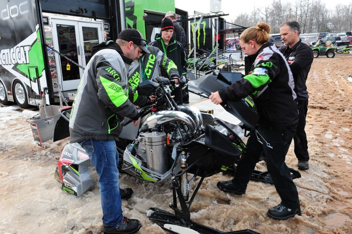 Working on Logan Christian's mod Arctic Cat. photo by ArcticInsider.com