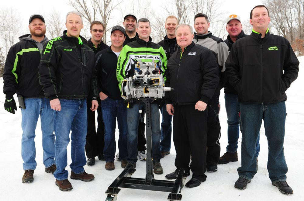 Arctic Cat personnel with the new C-TEC2 8000 engine in Jan. 2017. Photo by ArcticInsider.com