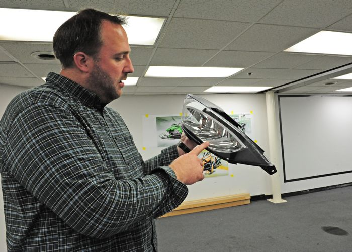 Arctic Cat's Nathan Blomker shows the LED headlight assembly. Photo by ArcticInsider.com