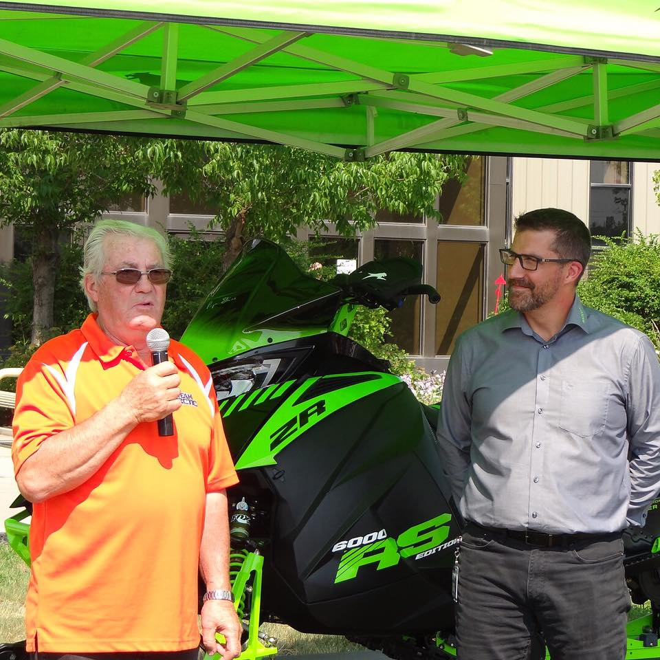 Arctic Cat's Roger Skime presented with his RS Edition snowmobile