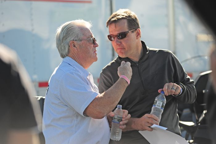 Arctic Cat's Roger Skime (L) talks with John Collins of Textron Off Road. Photo by ArcticInsider.