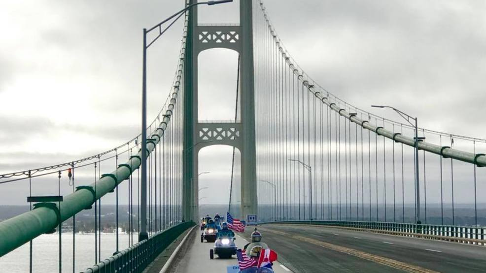 Snowmobiles crossing the mighty Mackinac bridge