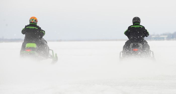 Arctic Cat engineers comparing snowmobile top-speed and acceleration.