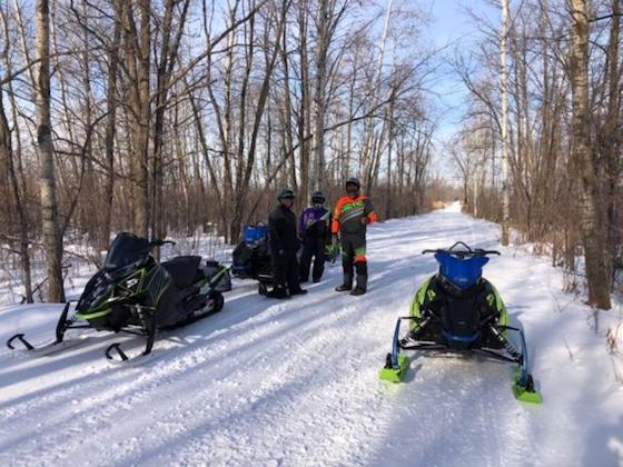 When the trails are this nice, it never hurts to stop and share your excitement on how much you love snowmobiling and discuss the obvious regarding how nice the trails are.