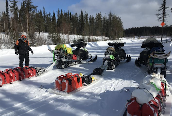 Paul Dick of Grand Rapids, Minn., looks over loaded-down tow sleds March 4 during the trek from Grand Rapids, Minn., to Churchill, Man., and back. Dick, along with Rob Hallstrom of Park Rapids, Minn., and Rex Hibbert of Henry, Idaho, logged 2,950 miles during the two-week adventure. (Photo courtesy of Rob Hallstrom)