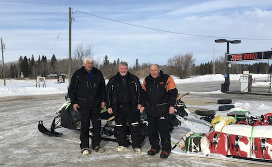 (L-R) Rex Hibbert, Rob Hallstrom and Paul Dick drew quite a following during the course of their epic snowmobile trip to Churchill, Man. Here, they stopped for a photo March 12 during a quick stop in Ethelbert, Man., north of Riding Mountain National Park. (Photo courtesy of Rob Hallstrom)