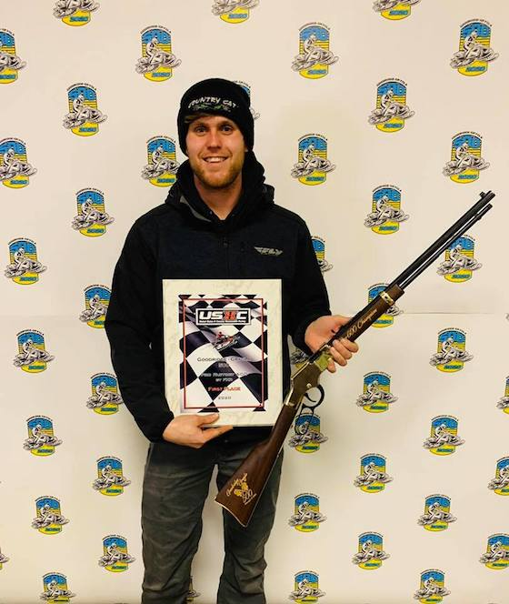 #312 Zach Herfindahl is Back-to-Back GG500 Champion posing with his custom USXC Henry Rifle