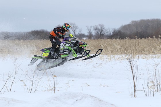#312 Zach Herfindahl navigating 5 miles of rough cattails in Warroad. Photo: Emily Pearl Photography