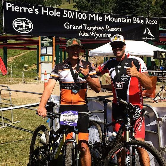 """Rob loved challenges. He found a love for """"them peddle bikes"""" a handful of years ago. And he was at the front of the pack during his first race! Pictured here Rob (L) and Garth Kaufman (R)"""