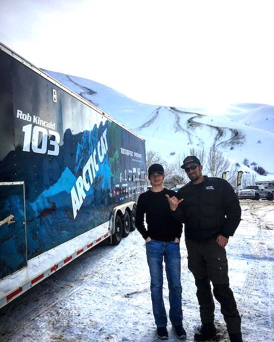 Rob and Riley standing by his race trailer
