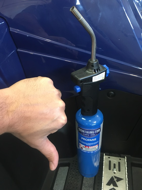 A Hair Dryer is your best friend when needing to warm a graphic. DON'T ever use a propane torch, and under most circumstance, a Heat gun can be overkill.