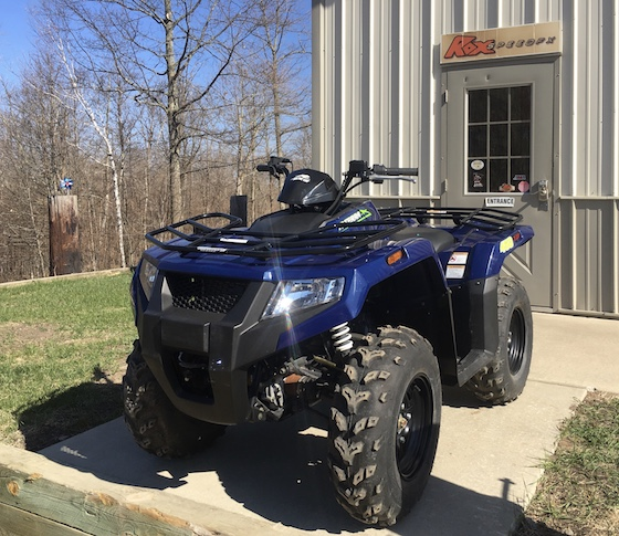 2019 Alterra 450 4x4 in stock form outside the Rox Speed FX shop
