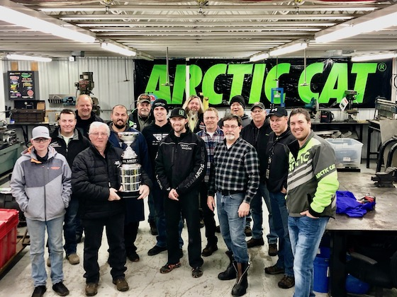 Mike Kloety orchestrated a group of past and present Arctic Cat employees and friends/family of Roger's to present him the Skime Traveling Cup