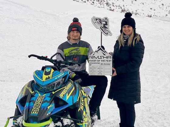 RMSHA presented Riley Kincaid (seated) and Kim Kincaid (R) Rob Kincaid's Racer of the Year Award