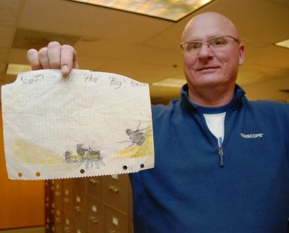 Joey Hallstrom shows a childhood drawing